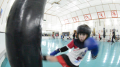 Young boxer at a boxer pear, working off shots hands and feet Stock Footage