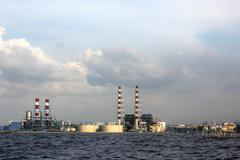 Refinery oil at side of the sea of North Jakarta Stock Photos