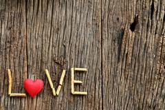 Word love with red heart shaped valentines day Stock Photos