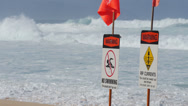 Stock Video Footage of Ocean wave dangerous rip currents sign