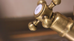 Vintage kitchen faucet in a modern house. - stock footage