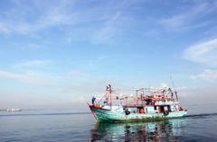Fisherman boat in port of Muara Angke - stock photo