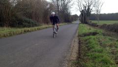 Road bike past out of saddle Stock Footage