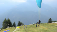 Stock Video Footage of Paragliders landing and taking off from mountain slope near Locarno on August 14
