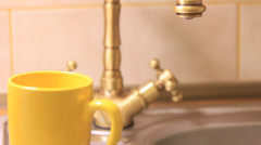 Vintage kitchen faucet in a modern house. Stock Footage