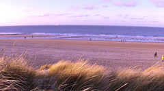 People walk by the winter sea. - stock footage
