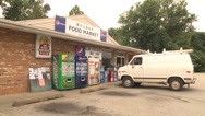 Stock Video Footage of small quick market store and white van