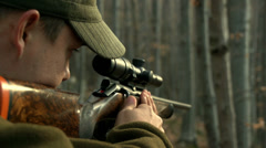 Hunter shot and loaded gun in slow motion Stock Footage