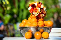 Beautiful bridal bouquet and oranges outdoors Stock Photos