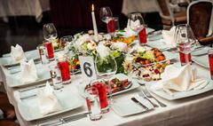 Luxury banquet table setting at restaurant Stock Photos