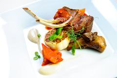 juicy lamb steak on a plate close-up - stock photo
