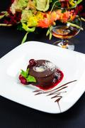 luscious chocolate dessert with fresh berries on a plate - stock photo