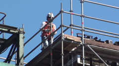 Man on scaffolding safety equipment - stock footage