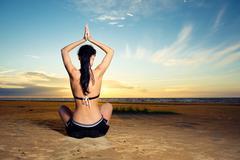 woman doing yoga exercise outdoors - stock photo