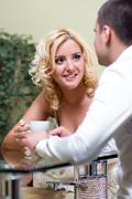 Young happy couple drinking coffee in a restaurant Stock Photos