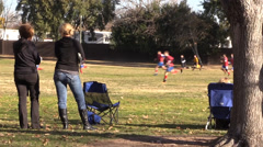 Soccer moms watching football Stock Footage