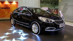 "Black KIA Cerato at yearly automotive-show ""SIA 2013"" in Kiev, Ukraine Stock Footage"