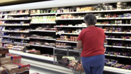Stock Video Footage of grocery store cheese and shopper