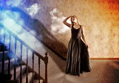 woman looking up at bright light of hope - stock illustration