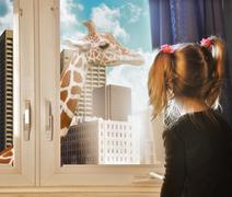 child looking at giraffe dream in window - stock illustration
