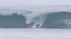 Surfer surfing in big wave north shore Hawaii banzai pipeline 1080 60P - stock footage