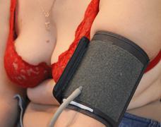 blood presuure measuring on the female hand - stock photo