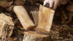 Man splitting logs with axe - stock footage