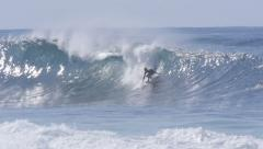 Surfer surfing in big wave north shore Hawaii banzai pipeline 1080 60P Stock Footage