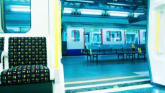 London Underground train stoping at stations Stock Footage