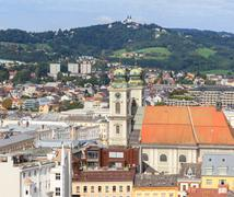 linz cityscape with old cathedral and poestlingberg, austria - stock photo
