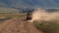 One safari vehicle leaves another one in the dust Stock Footage