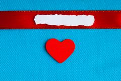 Valentines day background. paper blank heart on blue fabric material Stock Photos