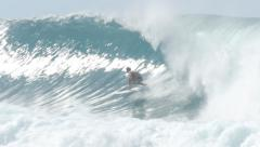 Surfer surfing in big wave north shore Hawaii banzai pipeline Stock Footage