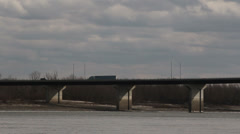 Semi truck exiting bridge from right to left Stock Footage