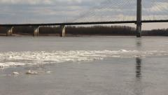 Ice floating in Mississippi River floating towards bridge Stock Footage