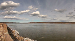 HDR time lapse of clouds over the Mississippi River Stock Footage