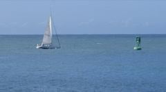 Sailboat sailing  away and bouy  Stock Footage