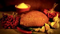 The stilllife with loaf, garlic, salt, pepper and viburnum. - stock footage