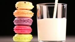 Multicolored macaroon and pouring milk Stock Footage