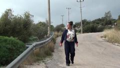 Walking Mother with child in sling Stock Footage