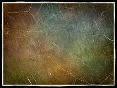 scratched grunge texture with frame border as abstract background. - stock photo