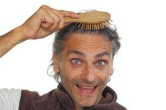 Man with hair brush Stock Photos