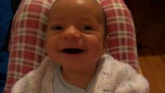 Portrait of cute baby smiling on camera Stock Footage