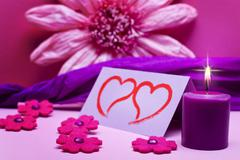 romantic pink background with candle - stock photo