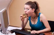 Stock Photo of pretty student eats a piece of pizza