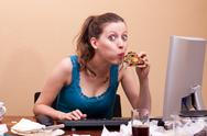 Stock Photo of pretty female student eats a piece of pizza
