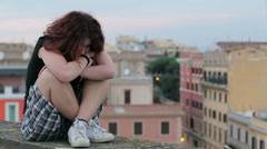 sad and depressed woman deep in thought outdoors - stock footage