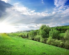 Sunbeams over the forest - stock photo