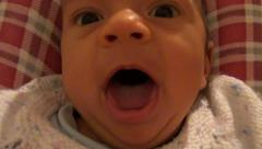 Baby yawning and then sneezing Stock Footage