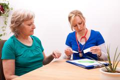 Advising a senior on the dose of medication Stock Photos